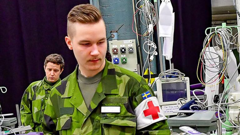 Swedish Army personal and civilian construction workers have been helping to prepare a field hospital in the Stockholm International Fairs facility