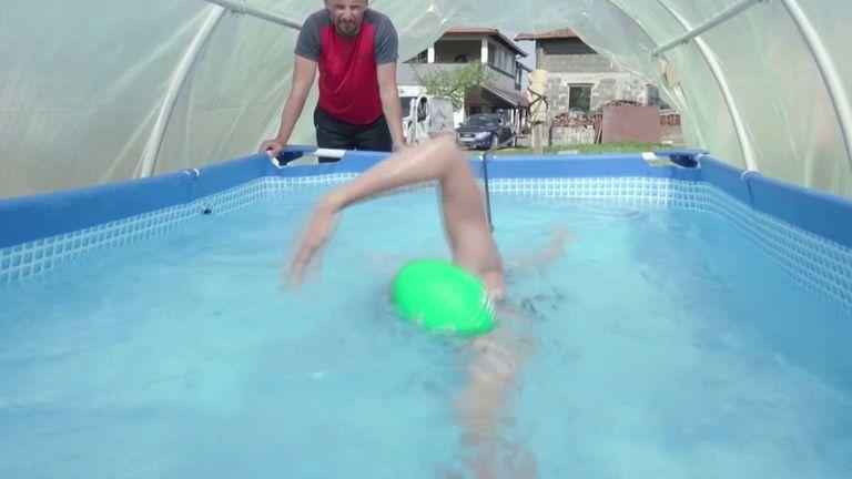 Bosnian junior swimming champion swims in homemade tank in greenhouse