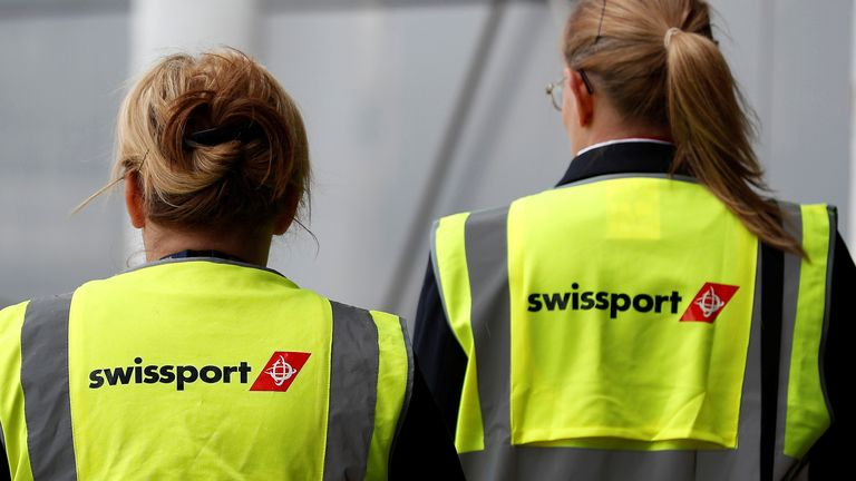 Swissport airport workers walk across the tarmac at Liverpool John Lennon Airport in Liverpool northern England, May 19 , 2016