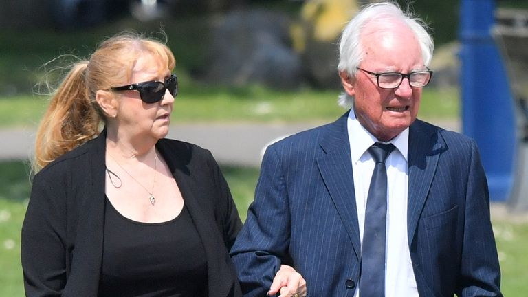 Syd Little and his wife, Sheree, arrive to see the hearse carrying Eddie Large's coffin