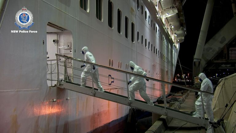 Police entering the Ruby Princess in PPE. Pic: New South Wales Police Force