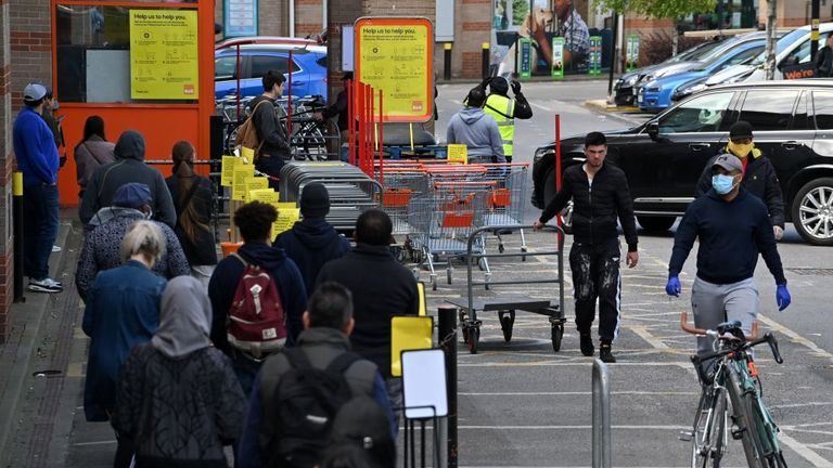 Customers queue outside the B&Q Warehouse, which has reopened after more than a month's closure, in south west London on April 25, 2020, during the national lockdown due to the novel coronavirus COVID-19 pandemic. - Prime Minister Boris Johnson is expected to return to work soon after his recovery from COVID-19, as pressure mounts on his government to explain how to get Britain out of lockdown. (Photo by JUSTIN TALLIS / AFP) (Photo by JUSTIN TALLIS/AFP via Getty Images)