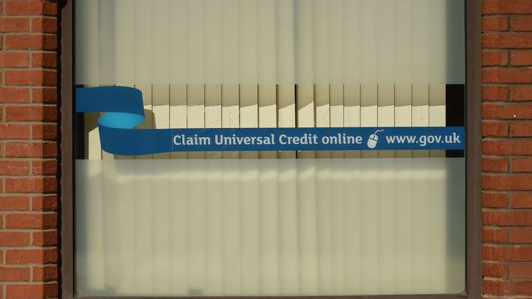 A sign with the email address of 'universal credit' is displayed outside the offices of 'jobcentreplus' in Oldham, Lancashire on March 26, 2020, during a country-wide lockdown to slow the spread of the novel coronavirus COVID-19. (Photo by Oli SCARFF / AFP) (Photo by OLI SCARFF/AFP via Getty Images)
