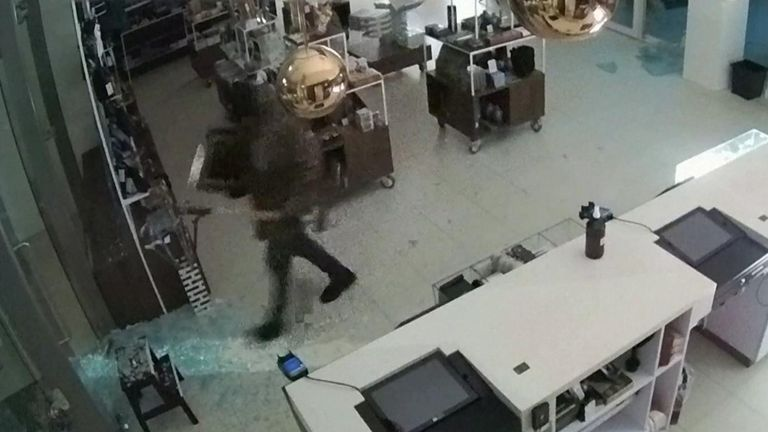 Armed with a sledge hammer, a thief was seen running through the museum's gift shop and smashing through the doors