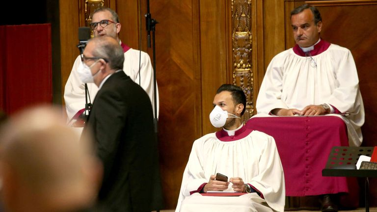 VATICAN CITY, VATICAN - APRIL 05: A singer of the Vatican choir attends Pope Francis' Palm Sunday Mass in an empty Vatican Basilica of St. Peter's due to the Covid-19 coronavirus pandemic, on April 05, 2020 in Vatican City, Vatican. Pope Francis greeted the faithful following his Palm Sunday Mass and Angelus and prayed for the sick and their families, and all those who self-sacrificingly care for them. (Photo by Franco Origlia/Getty Images)