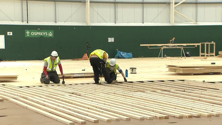 Special flooring is being fitted for the new field hospital