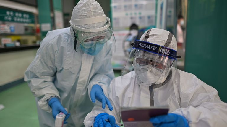 Medical workers take swab samples from people to be tested for the COVID-19 novel coronavirus in Wuhan, China
