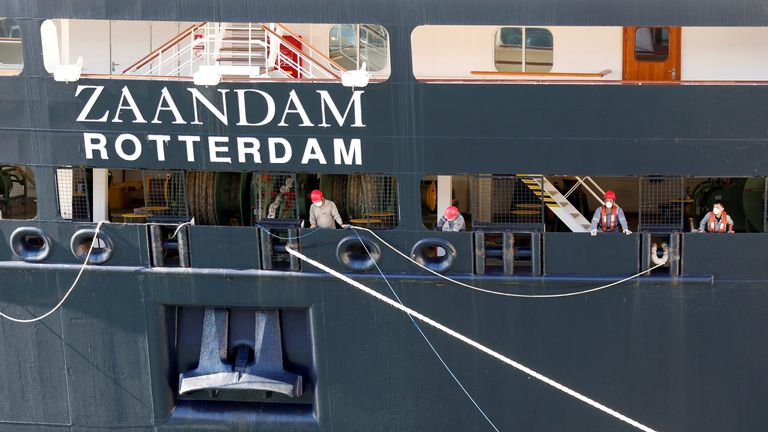 Crew members of the Zaandam, one of the two Holland America Line cruise ships which have been afflicted with coronavirus disease (COVID-19), are seen as the vessel ties up at Port Everglades in Fort Lauderdale, Florida, U.S. April 2, 2020. REUTER/Joe Skipper