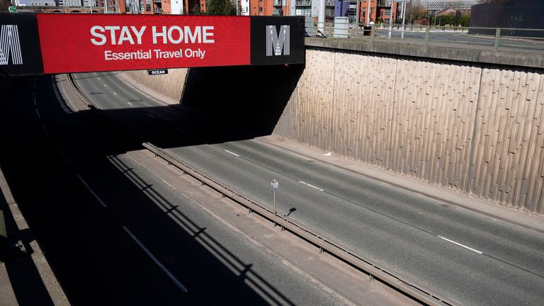 A giant screen over the A57 Motorway urges people to stay home in Manchester