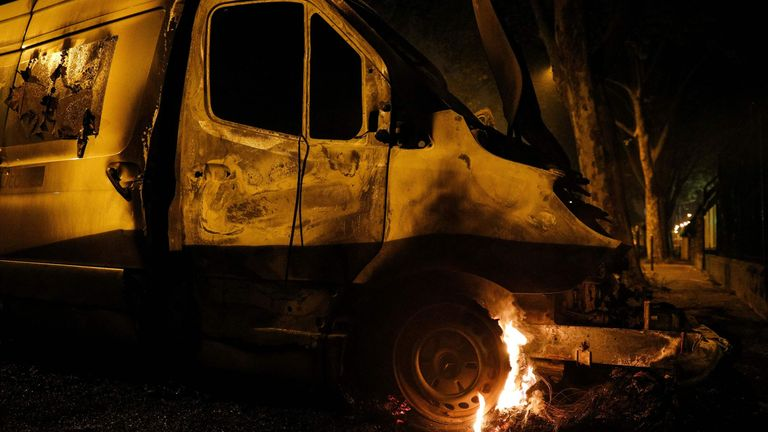 The wheel of a van burns in Villeneuve-la-Garenne, in the northern suburbs of Paris, early on April 20, 2020. - Tension with the police erupted again on the evening of April 19 in Villeneuve-la-Garenne near Paris, where a motorcycle accident involving the police had provoked the first clashes with residents the day before. (Photo by GEOFFROY VAN DER HASSELT / AFP) (Photo by GEOFFROY VAN DER HASSELT/AFP via Getty Images)