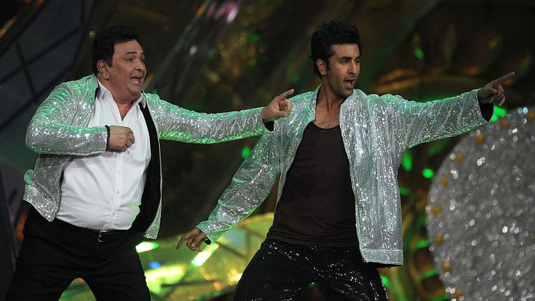 Kapoor performs with his son Ranbir at an awards ceremony in 2012