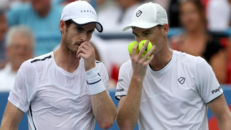 Andy Murray (L) and his brother Jamie Murray of Great Britain confer during their doubles match against Nicolas Mahut and Edouard Roger-Vasselin of France during Day 3 of the Citi Open at Rock Creek Tennis Center on July 31, 2019 in Washington, DC.