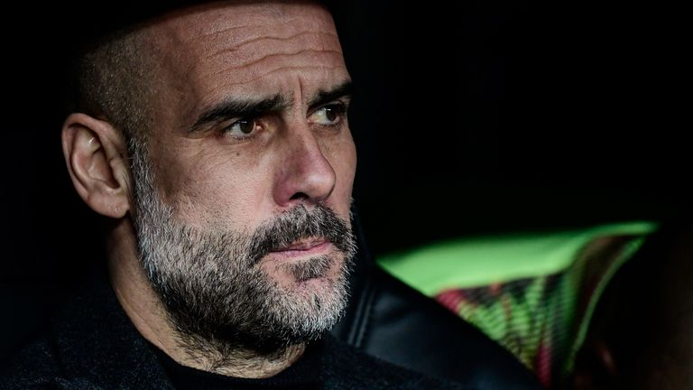 Manchester City manager Pep Guardiola on the bench at the Santiago Bernabeu