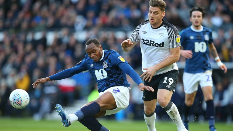 Ryan Nyambe of Blackburn Rovers wins the ball from Derby County's Chris Martin