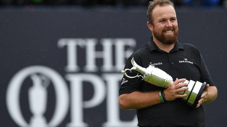 Shane Lowry poses with the Claret Jug after winning last year's The Open at Royal Portrush