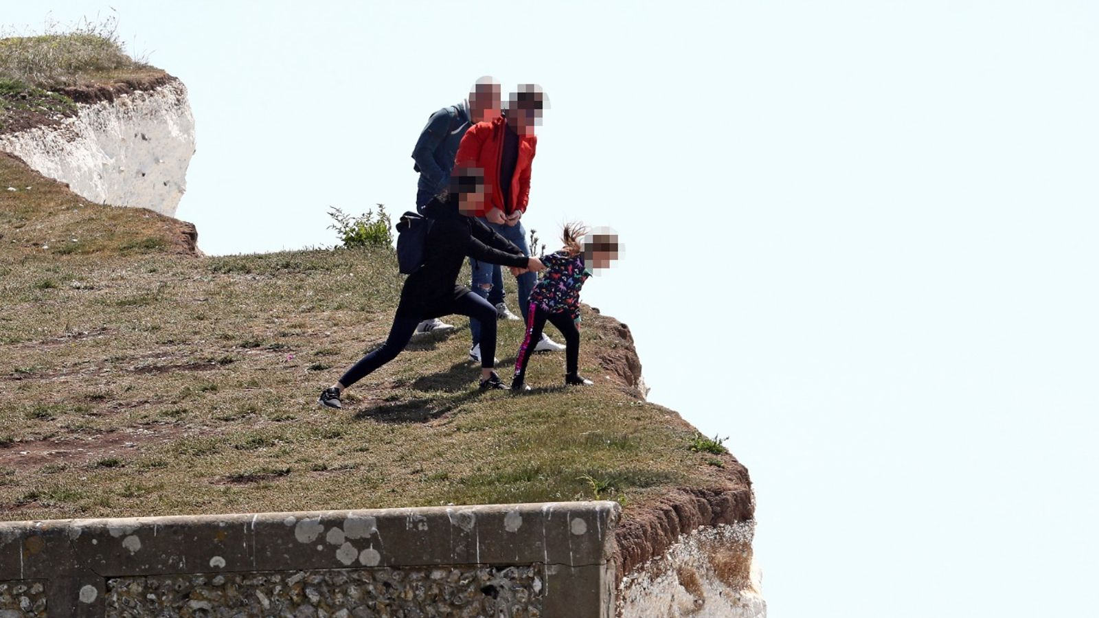 Birling Gap: Warning after young girl pictured being pulled from cliff edge