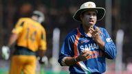 Indian cricketer Sachin Tendulkar shines the ball