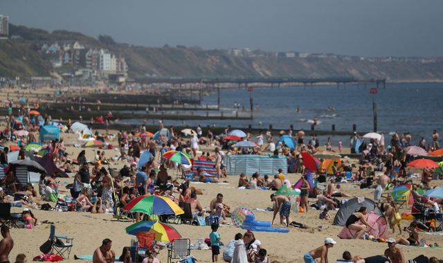 Coronavirus: Coast roads 'gridlocked' by cars 'from all over country' as thousands enjoy hottest day of year