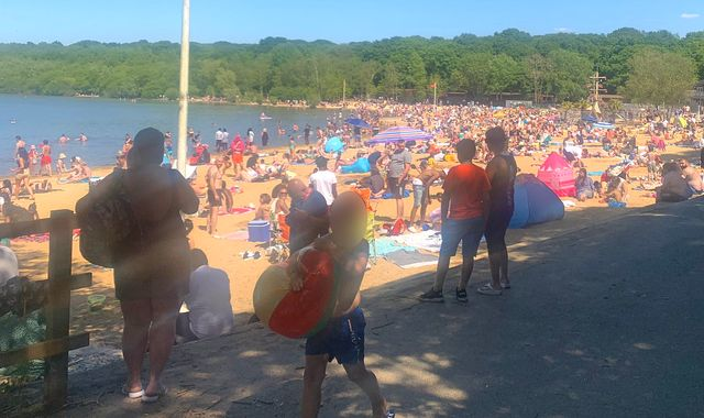 Coronavirus: Police called to 'large group gathering' as Britons flock to beaches during hot Bank Holiday Monday