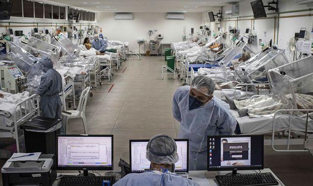 Coronavirus cases worldwide top five million