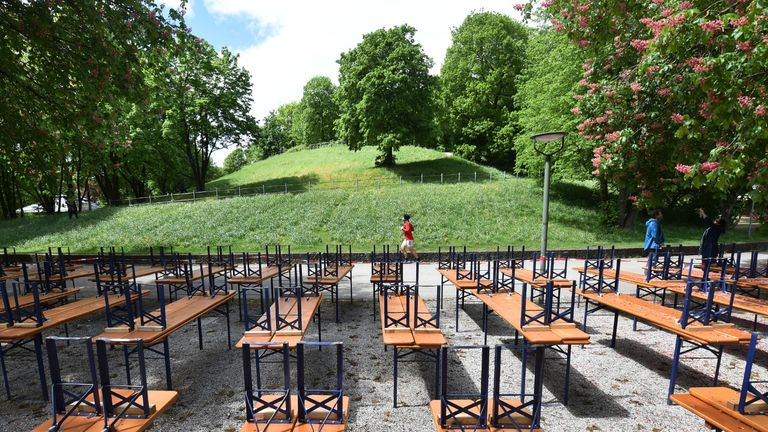 Tables and benches of a closed beer garden are seen in Munich, southern Germany, on May 1, 2020, where public life in the city is very limited due to the coronavirus COVID-19 pandemic. (Photo by Christof STACHE / AFP) (Photo by CHRISTOF STACHE/AFP via Getty Images)
