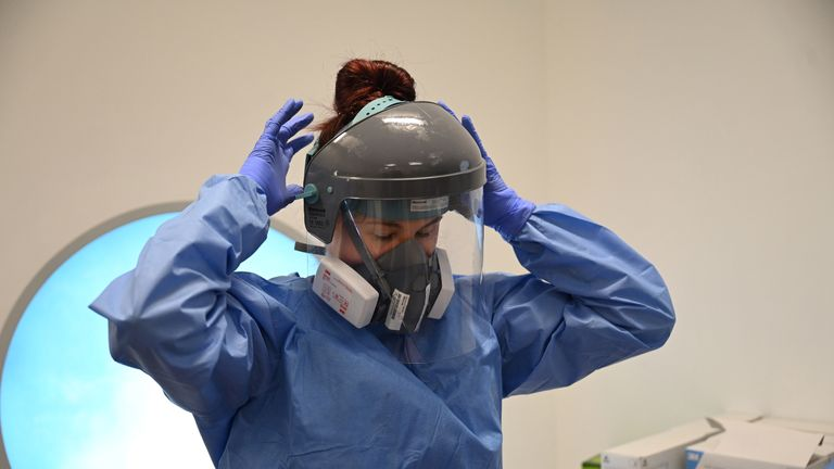 CAMBRIDGE, UNITED KINGDOM - MAY 05: Clinical staff put on Personal Protective Equipment (PPE)  at the Intensive Care unit at Royal Papworth Hospital on May 5, 2020 in Cambridge, England. NHS staff wear an enhanced level of PPE in higher risk areas such as critical care to minimise the spread of infection between staff and patients. Countries around the world are taking increased measures to stem the widespread of the SARS-CoV-2 coronavirus which causes the Covid-19 disease. (Photo by Neil Hall - Pool/Getty Images)
