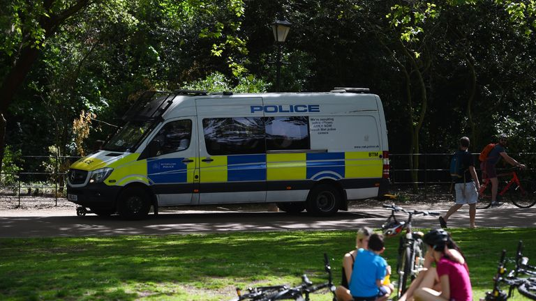 Police drive through Battersea Park, London, reminding people that lockdown restrictions are still in place, as the UK continues in lockdown to help curb the spread of the coronavirus.
