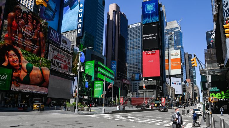 NEW YORK, NEW YORK - MAY 12: People wearing protective face masks are seen in a nearly empty Times Square during the COVID-19 pandemic on May 12, 2020 in New York City. COVID-19 has spread to most countries around the world, claiming over 291,000 lives with infections of over 4.3 million people. (Photo by Ben Gabbe/Getty Images)