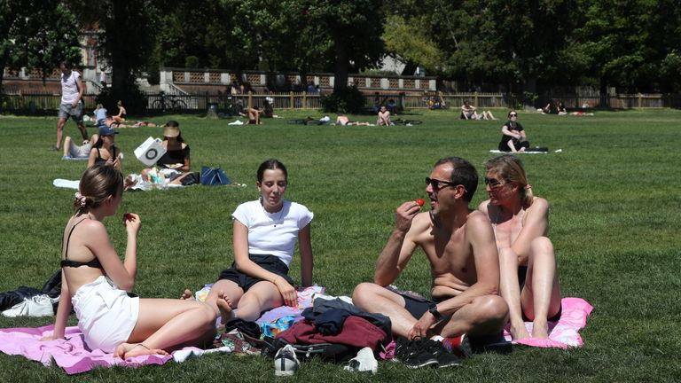 People enjoy the hot weather in Holland Park Playing Fields, London, as people flock to parks and beaches with lockdown measures eased.