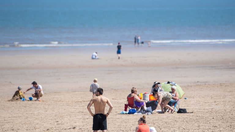Sunbathers enjoy the hot weather at Mablethorpe in Lincolnshire, as people flock to parks and beaches with lockdown measures eased.