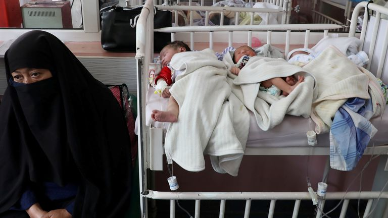 Newborn children who lost their mothers in a bombing attack lie on a bed at a hospital in Kabul, Afghanistan