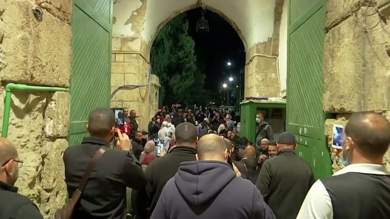 Worshippers are seen entering the Al-Aqsa Mosque in Jerusalem