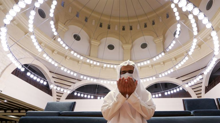 A Saudi man wearing a protective face mask performs the Al-Fajr prayer inside the Al-Rajhi Mosque, after the announcement of the easing of lockdown measures amid the coronavirus disease (COVID-19) outbreak, in Riyadh