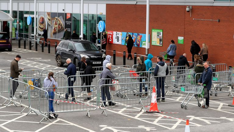 Members of the public observe social distancing measures whilst they queue for Asda in Grantham, Lincolnshire as the UK continues in lockdown to help curb the spread of the coronavirus. PA Photo. Picture date: Saturday March 28, 2020. See PA story HEALTH Coronavirus. Photo credit should read: Mike Egerton/PA Wire