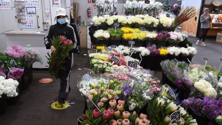 A florist arranges her Mother's Day display in Melbourne