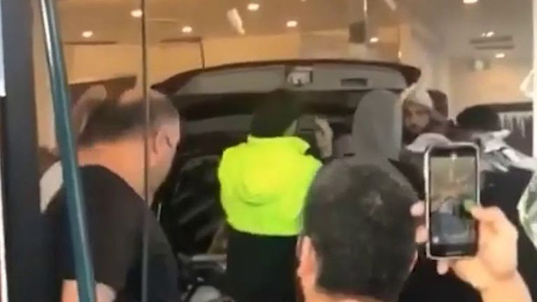 Several injured as car crashes into shop in Sydney