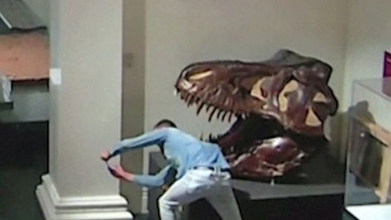Paul Kuhn was captured on CCTV posing for a selfie with a dinosaur skull