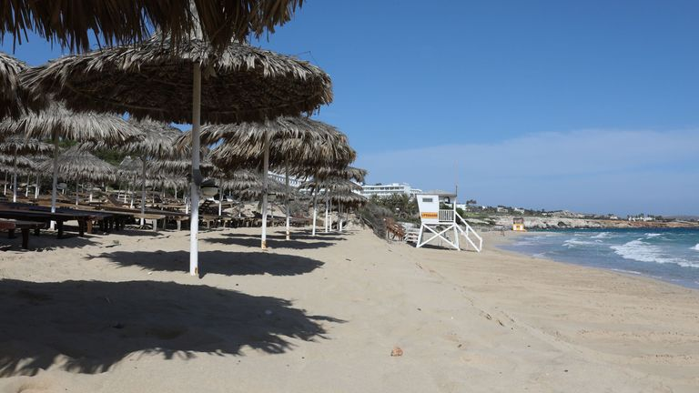 A deserted beach is pictured in the Cypriot resort town of Ayia Napa on May 4, 2020, as the island country gradually eases its lockdown restrictions placed for the COVID-19 coronavirus pandemic. - Cyprus revealed a plan to gradually ease coronavirus lockdown measures and reboot the Mediterranean holiday island's economy. The Republic of Cyprus, which controls the southern two-thirds of the divided island, had imposed strict measures soon after its first novel coronavirus cases were confirmed on