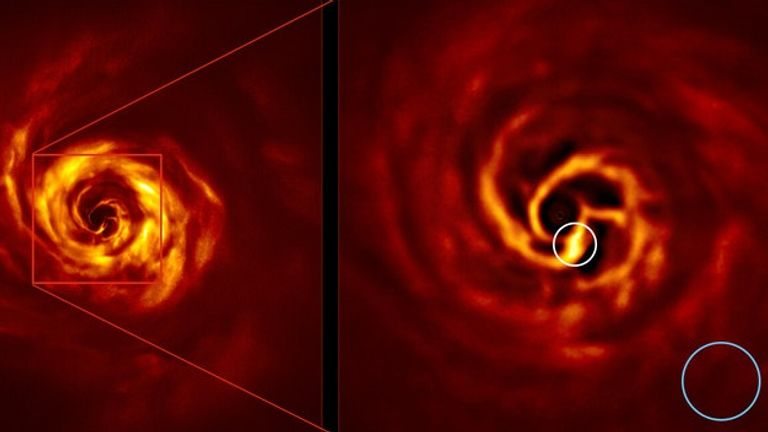 EMBARGOED TO 1300 WEDNESDAY MAY 20 Undated handout photo issued by the European Southern Observatory (ESO) showing the AB Aurigae system. The image on the right shows the inner region of the disc, including the bright yellow twist, circled in white. The twist lies at about the same distance from the star as Neptune from the Sun and blue circle represents the size of the orbit . Astronomers believe they may have found the first direct evidence of a new planet being born.