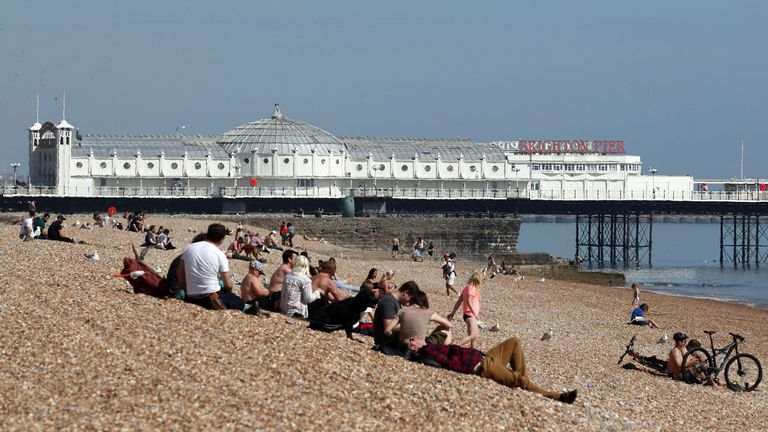 People on the beach in Brighton on Friday