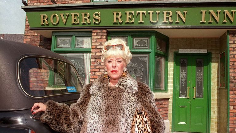 Bet Lynch (Julie Goodyear) in front of the Coronation Street pub, the Rovers Return, in 1995
