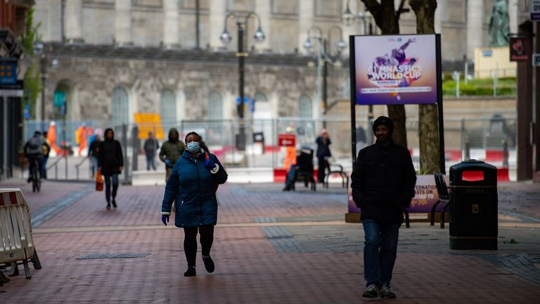 Pedestrians walking on Hill Street in Birmingham city centre, as the UK continues in lockdown to…