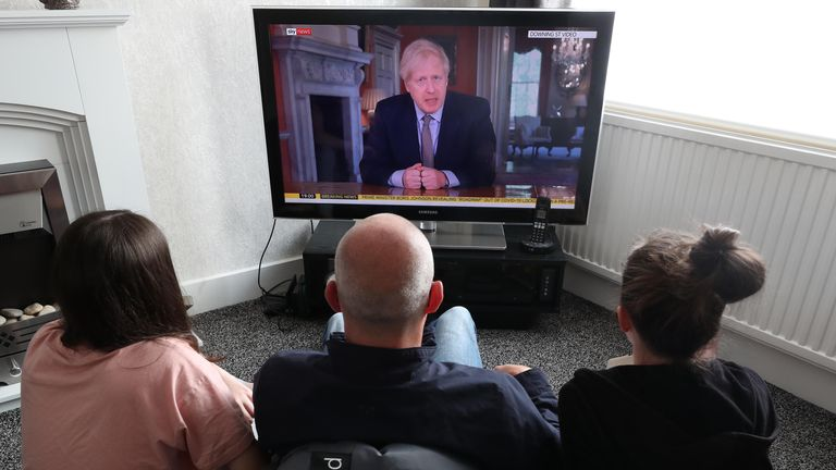 People in a house in Liverpool watch Prime Minister Boris Johnson addressing the nation about coronavirus