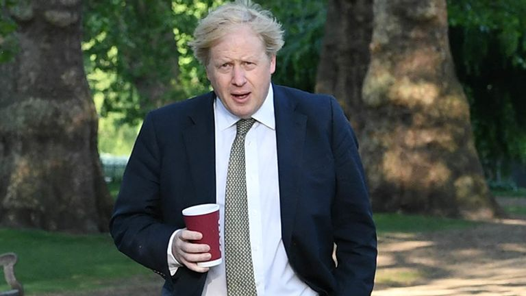 Boris Johnson takes a morning walk in St James's Park in London before returning to Downing Street