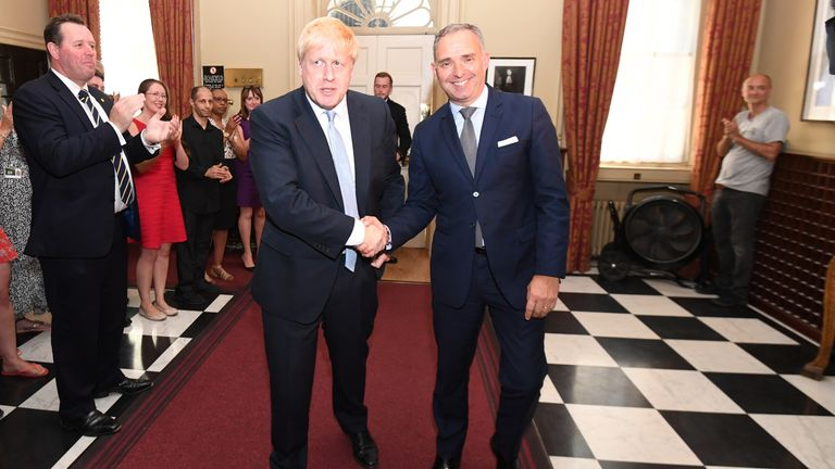 Boris Johnson shaking hands with Sir Mark Sedwill as he enters Number 10 for the first time as Prime Minister. Dominic Cummings is seen in the background on the right