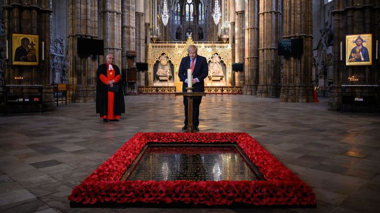Boris Johnson lights a candle at the Grave of the Unknown Warrior