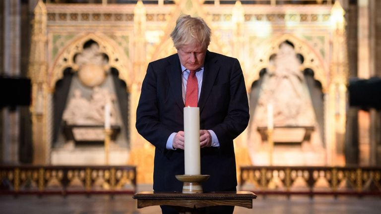 Boris Johnson has lit a candle of remembrance at Westminster Abbey