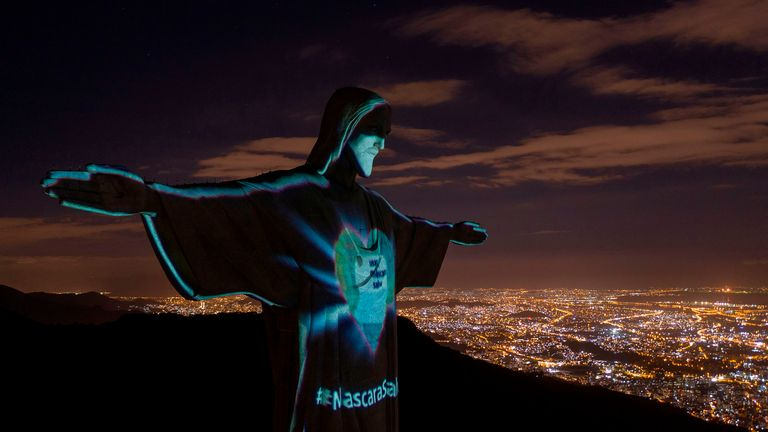The Christ the Redeemer statue is seen illuminated wearing a face mask calling society to wear them to prevent the spread of the novel coronavirus in Rio de Janeiro, Brazil on May 03, 2020