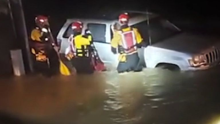 Woman is rescued from car in flood waters in Virginia