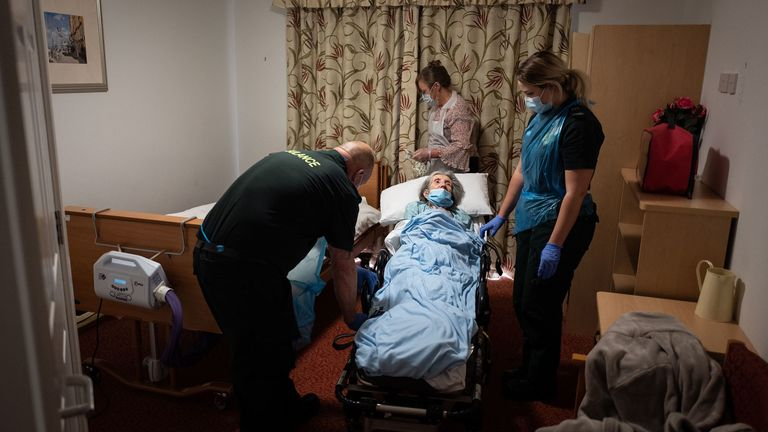 An elderly non-COVID-19 patient is settled into a care home after moving from a nearby hospital in Portsmouth